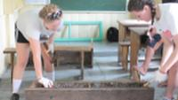 Fixing the tables during a Service Learning trip in Vietnam |  <i>HG Travel</i>