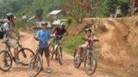 Family cycling in Northern Laos |  <i>Kate Baker</i>