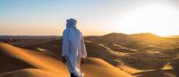 A local man walks atop sand dunes in the Sahara, Morocco | James Griesedieck