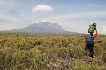 Porter heading towards Kilimanjaro&#160;-&#160;<i>Photo:&#160;Kyle Super</i>