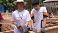 Student's assisting with building a house for a local family in need
