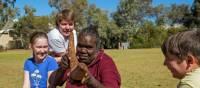 Having fun during an Aboriginal art workshop at Uluru | Tourism NT/Shaana McNaught