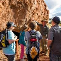 Ranger guided walk around the base of Uluru   Tourism NT/Shaana McNaught