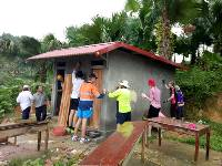 Students constructing new toilets for a remote school in Vietnam
