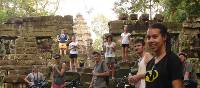 Students cycling around Angkor Wat | John Nichol