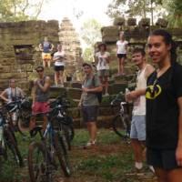 Students cycling around Angkor Wat | John Nichol