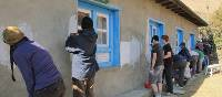 Painting a local school in Nepal | Greg Pike