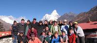 School group in Nepal, Ama Dablam towers behind them | Greg Pike