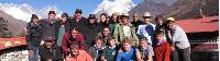 School group in Nepal, Ama Dablam towers behind them |  <i>Greg Pike</i>