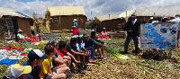 Students learning about Lake Titicaca | Drew Collins