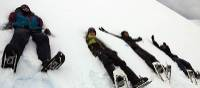 Students making snow angels in Antarctica | Brendan Stewart