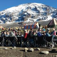 Breakfast under a clear blue sky and under the watchful eye of the Mountain, Karanga Camp | Eva Moons