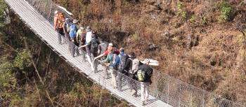 Students cross a bridge in the Everest region of Nepal | Greg Pike